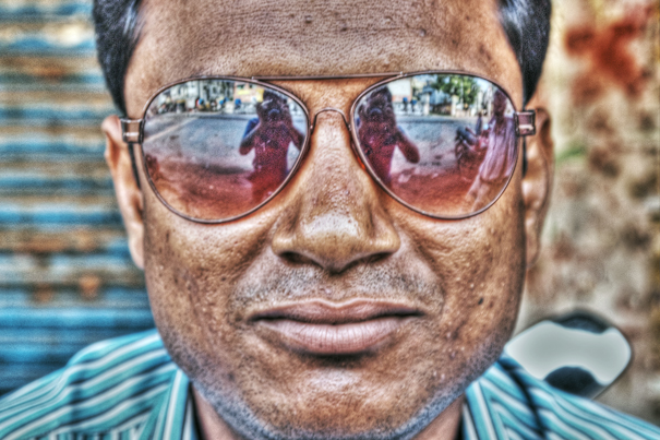 Figure On His Sunglasses (India)