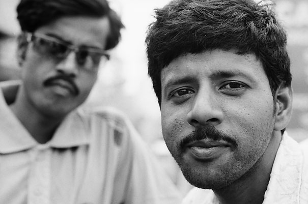 Two men looking at my camera