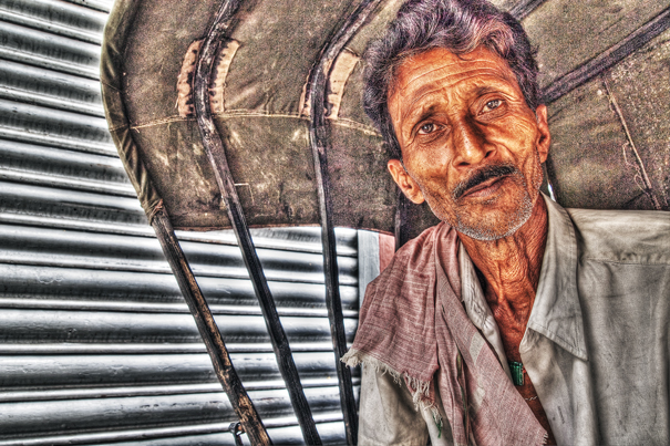 Rickshaw Wallah With A Mustache Sitting On The Seat (India)