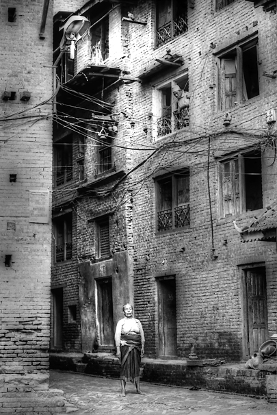 Woman Rising To Her Full Height In The Lane @ Nepal