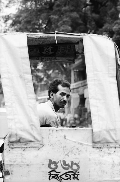 Rickshaw wallah looking back