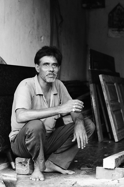 Resting Shoeless Craftsman @ India