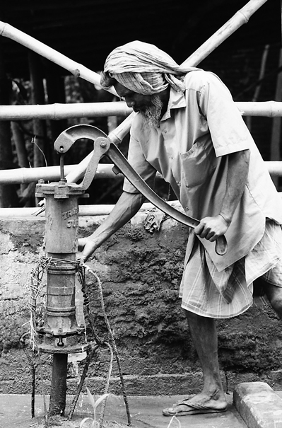 Man Getting Some Water From A Well (India)