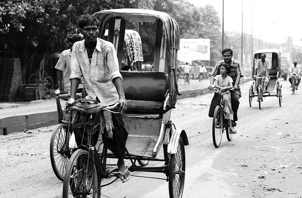 Cycle Rickshaws And Bicycles On The Street (India)