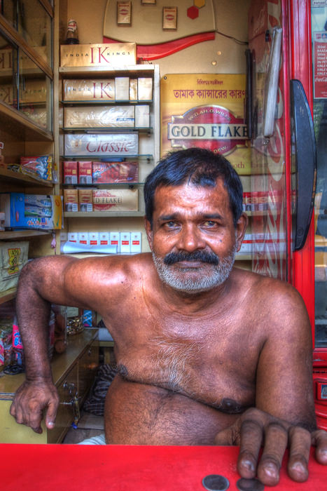 Tobacconist Was Stripped To His Waist (India)