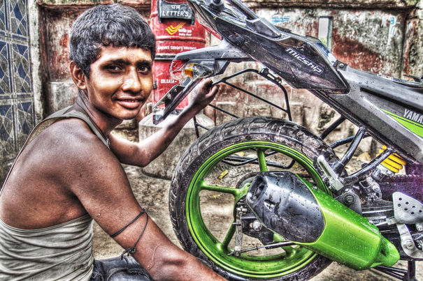 Man And A Rear Wheel (India)