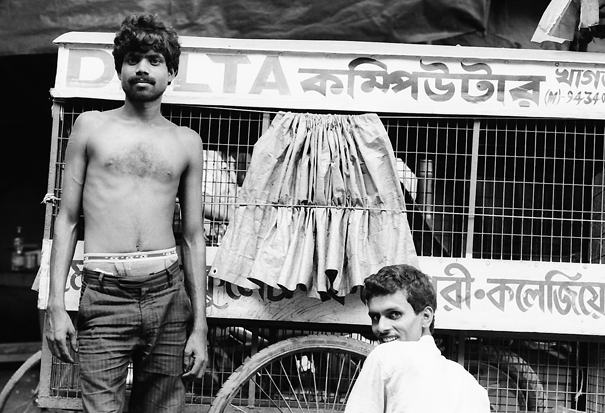 Two men beside cage