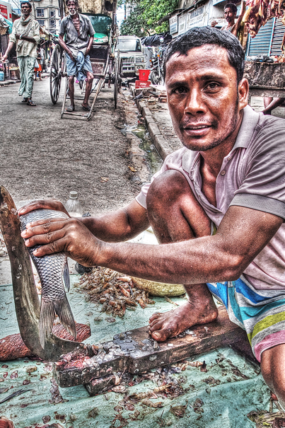 Man Cutting A Fish @ India