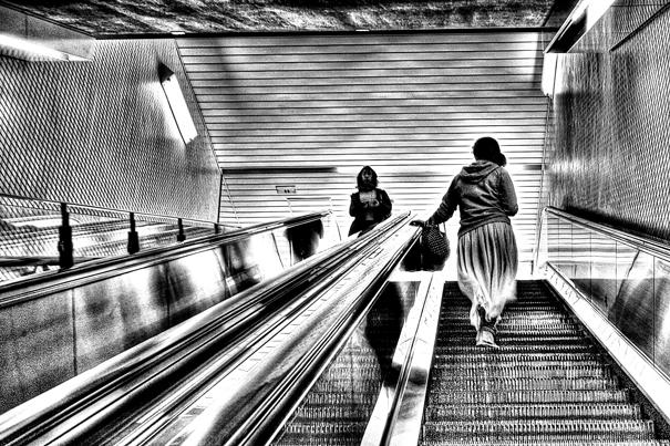 Woman on escaltor