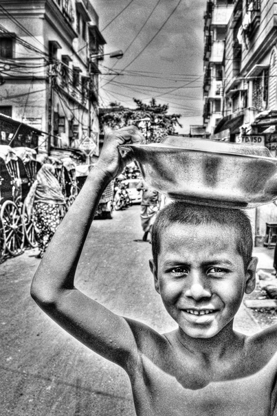 Boy with tray on head