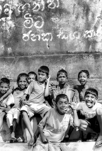 Cheerful Boys Gathered Against The Wall (Sri Lanka)