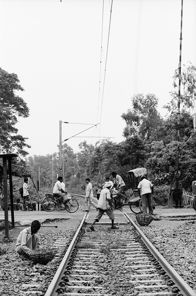 People On The Rail Crossing (India)