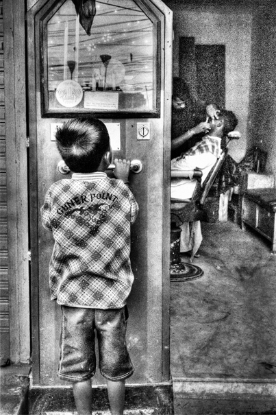 Boy In Front Of A Barber (India)
