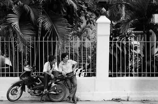 A Motorbike And Two Men