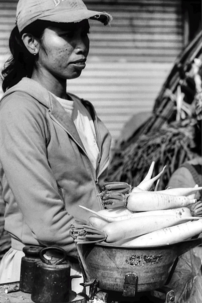 Woman selling radish