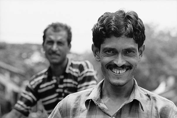 Smiling Man And Uninterested Man (India)