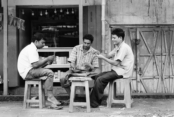 Men playing cards in storefront