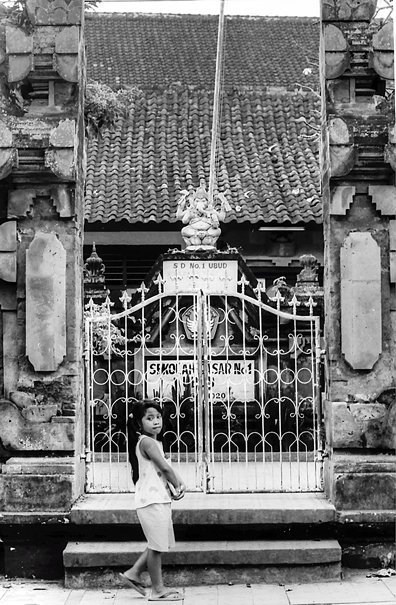 Girl walking in front of gate