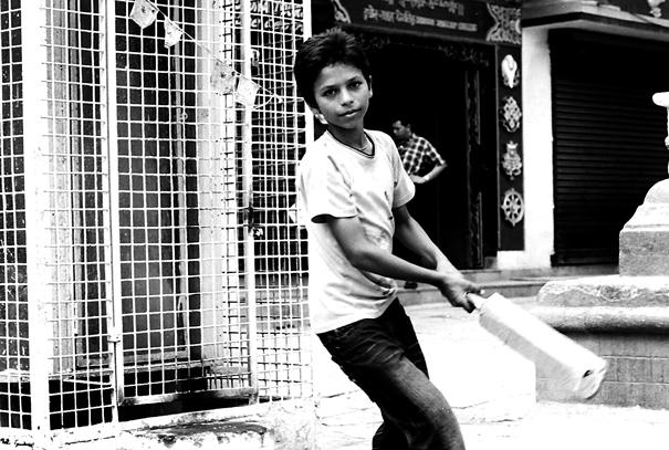 Boy Swinging A Bat (Nepal)