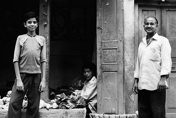 Two Standing Men And A Sitting Man (Nepal)