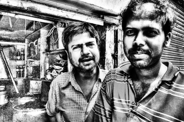 Two Men In The Storefront @ India