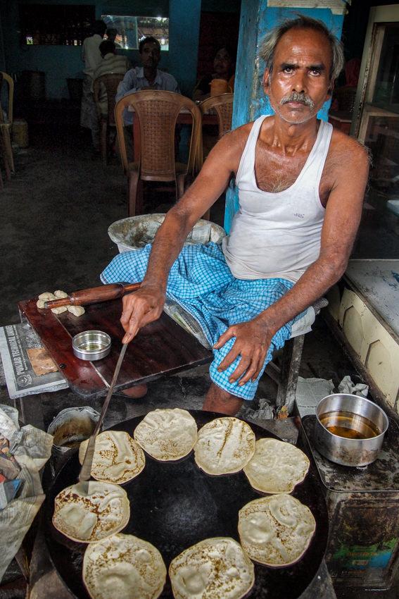 Man baking Roti