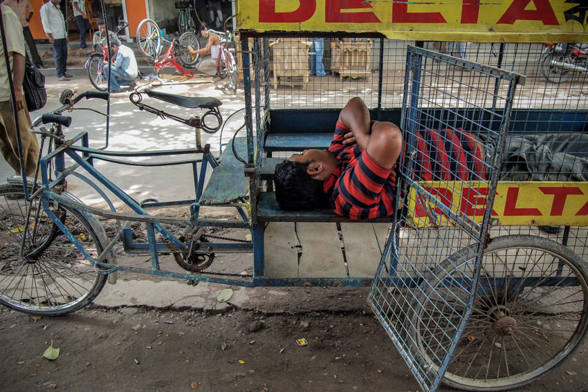 Man sleeping in cage