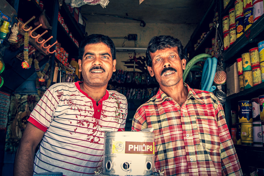 Two men in small shop