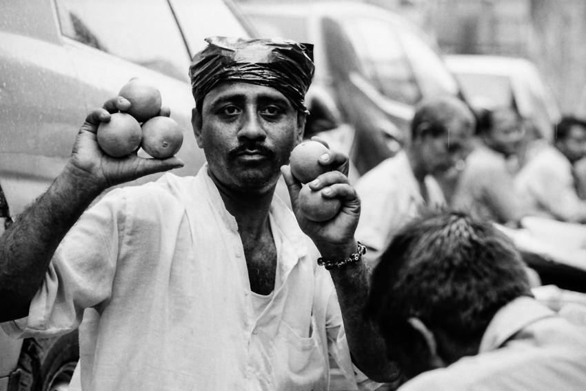 Man having oranges in hands