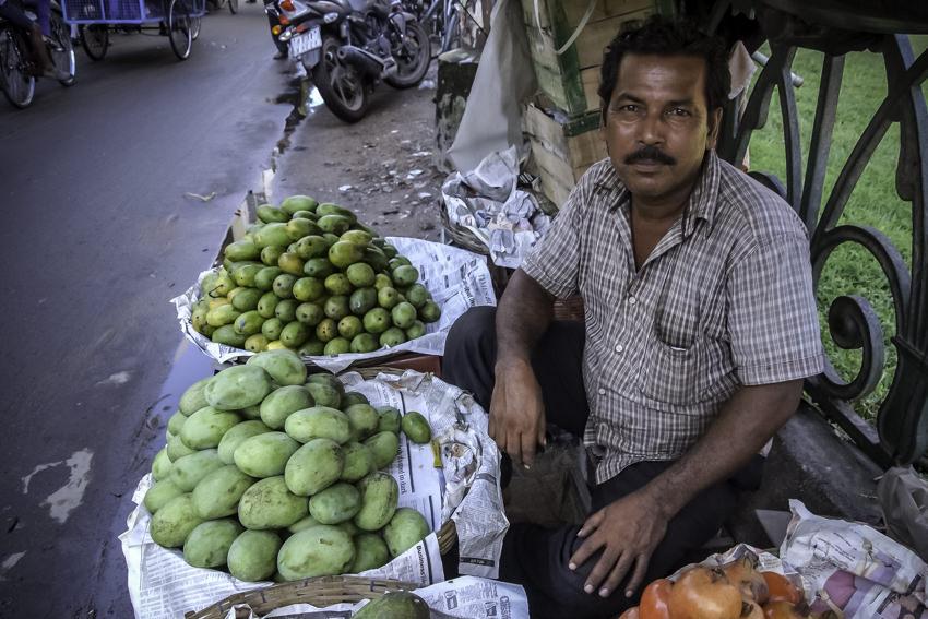 Man selling mango and pomegranate
