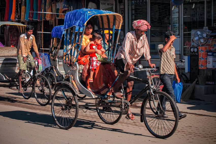 Mother and baby on cycle rickshaw