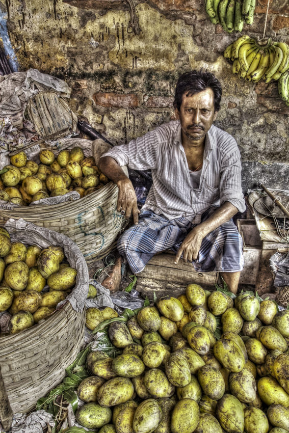 Man surrounded by mangoes