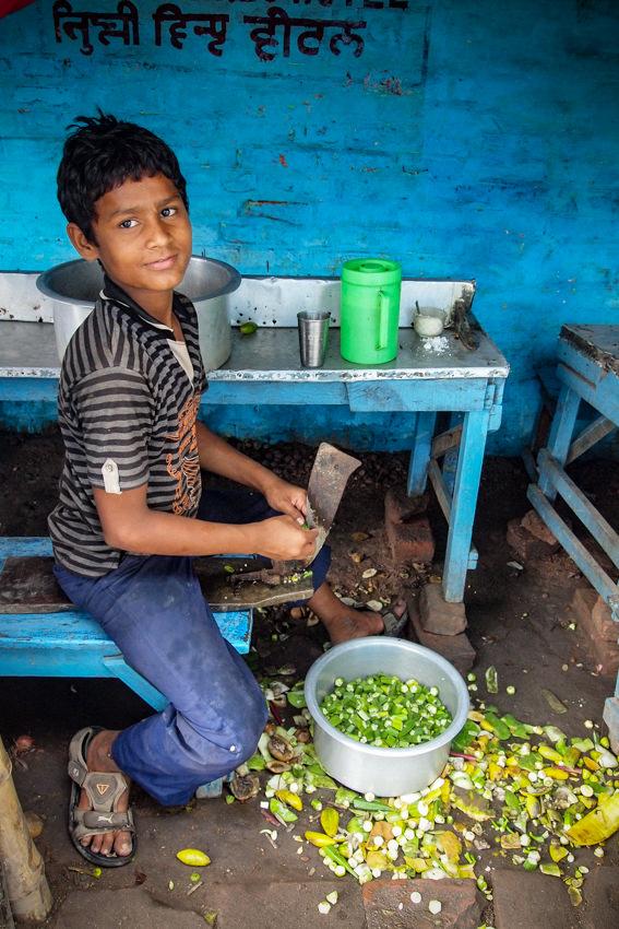 boy cutting vegetables