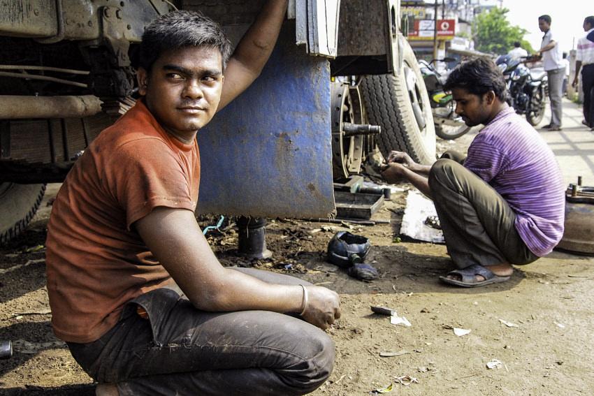 Men repairing truck