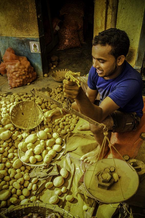 Man weighing potatoes
