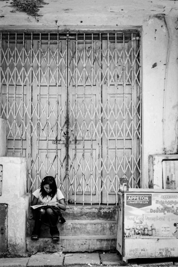 Girl studying by roadside