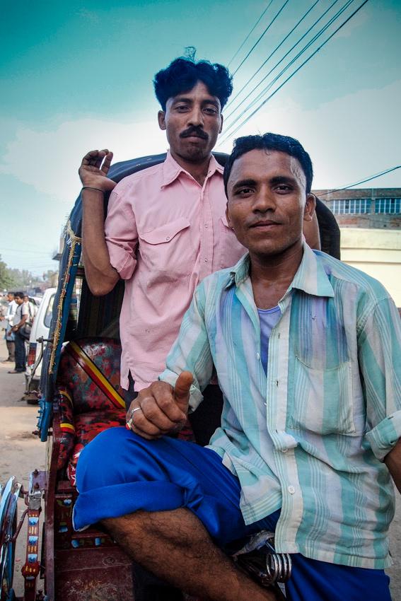 Two men chatting on cycle rickshaw