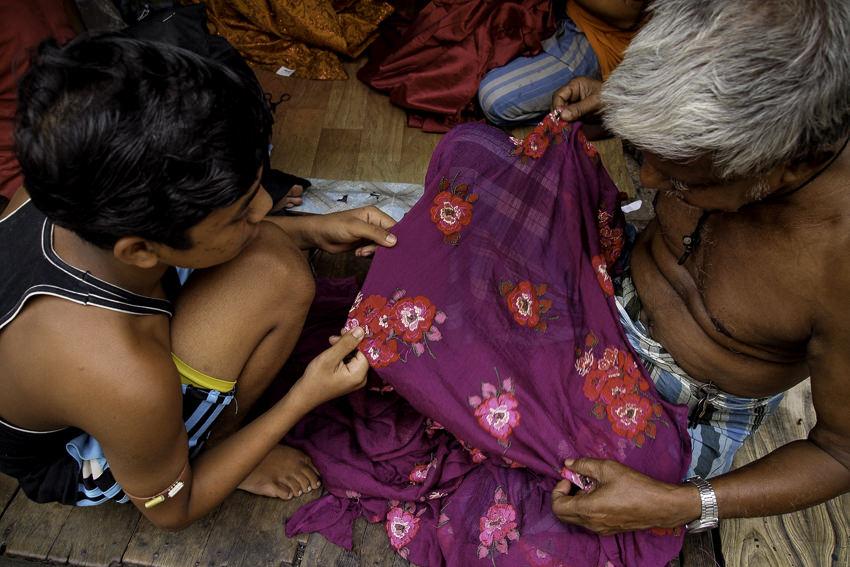 Craftsmen doing needlework