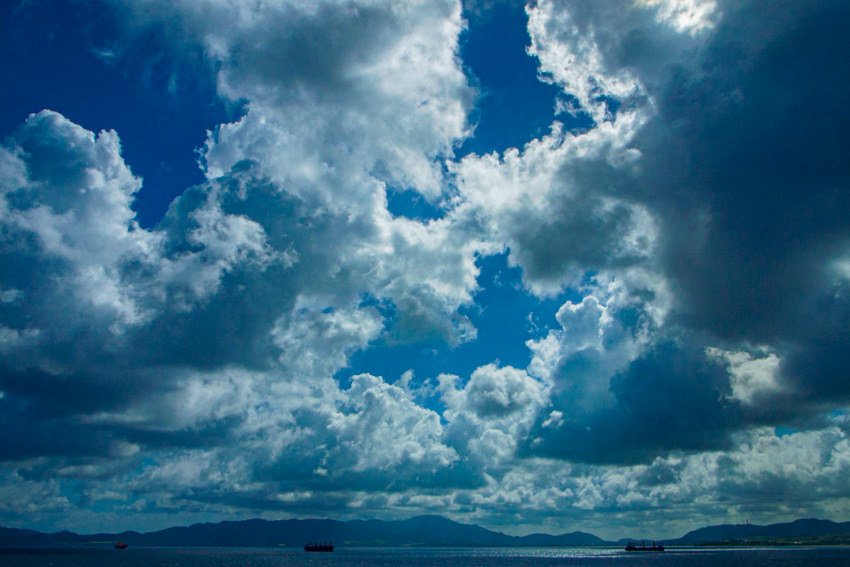 Freight vessels under clouds