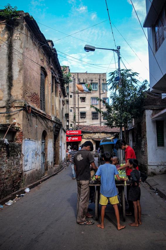Men gathering around street vendor