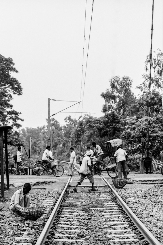 People on rail crossing