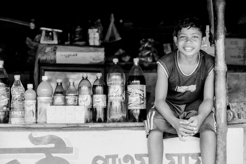 Boy sitting beside plastic bottles