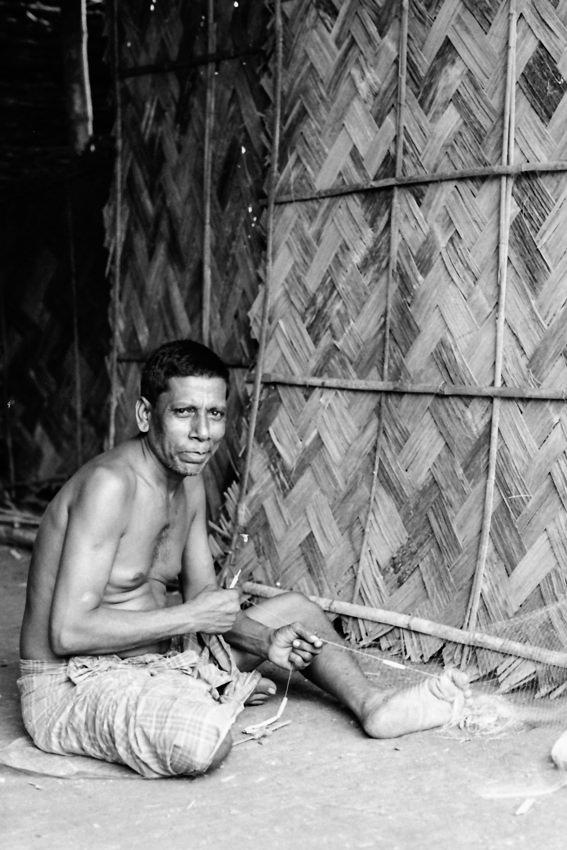 Man repairing fishnet