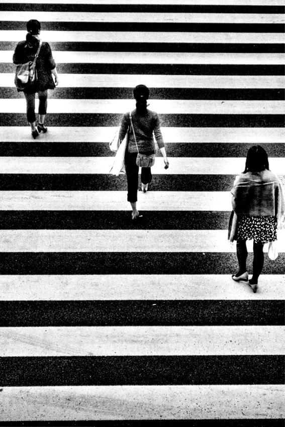 three women on pedestrian crossing