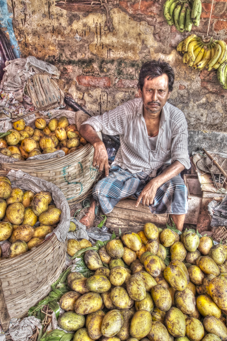 Heap Of Mangoes And A Man (India)