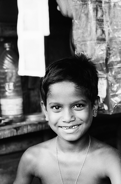 Boy Working At A Small Shop (India)