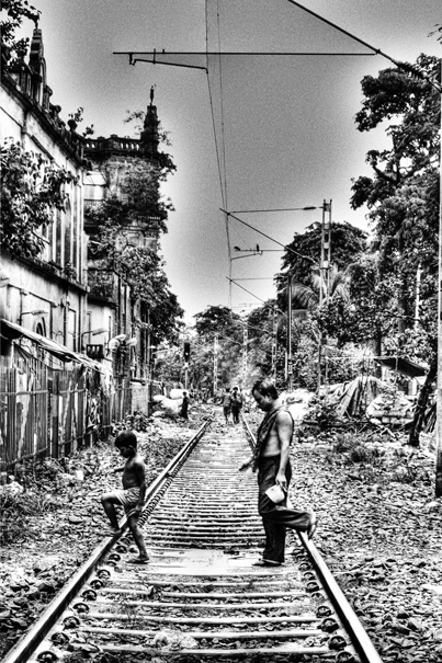 Boy And Man On The Railroad @ India