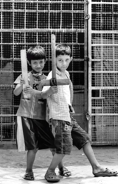 Two boys holding bat