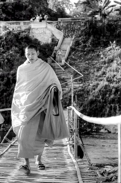 Monk On The Shabby Bridge @ Laos