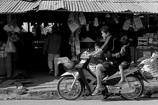 A Motorbike In Front Of Shops @ Laos